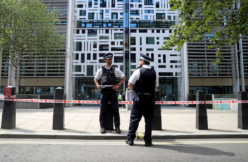 Police officers stand guard in front of the Home Office in London, Britain August 15, 2019. — Reuters pic