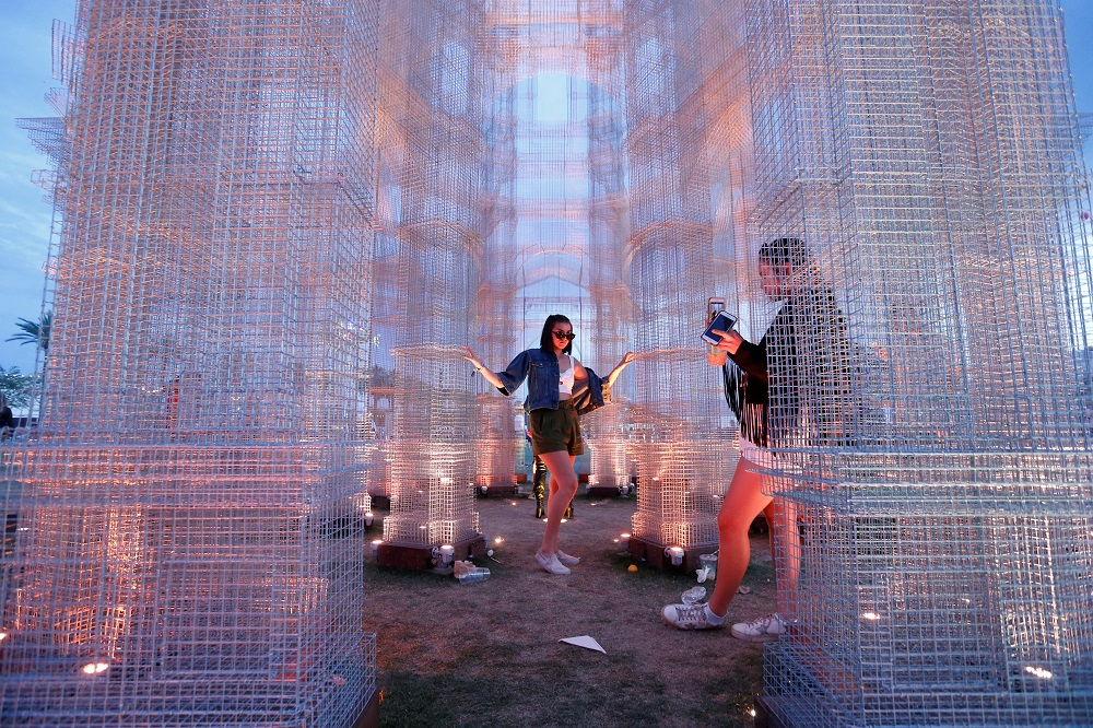 A concertgoer poses for as photo inside the installation called 'Etherea' by Edoardo Tresoldi at the Coachella Valley Music and Arts Festival in Indio, California April 15, 2018. — Reuters pic