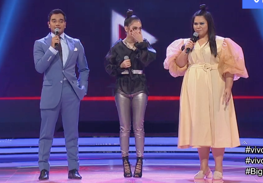 Alif Satar (left) did not simply stand by while his co-host Sherry Alhadad (right) was made fun of during a live broadcast. — Screengrab via YouTube/Astro Gempak