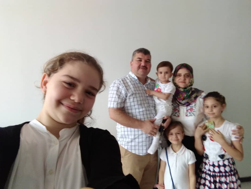 Arif Komis (second from left) is wanted by Turkey on charges of being a member of an armed terrorist organisation. — Picture via Twitter/Global Rights Issues