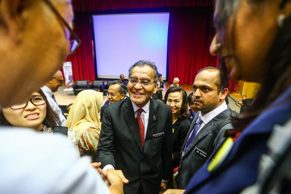Health Minister Datuk Seri Dzulkefly Ahmad mingles with people after the Health Ministry Town Hall Session with pharmacists in Putrajaya August 8, 2019. — Picture by Hari Anggara