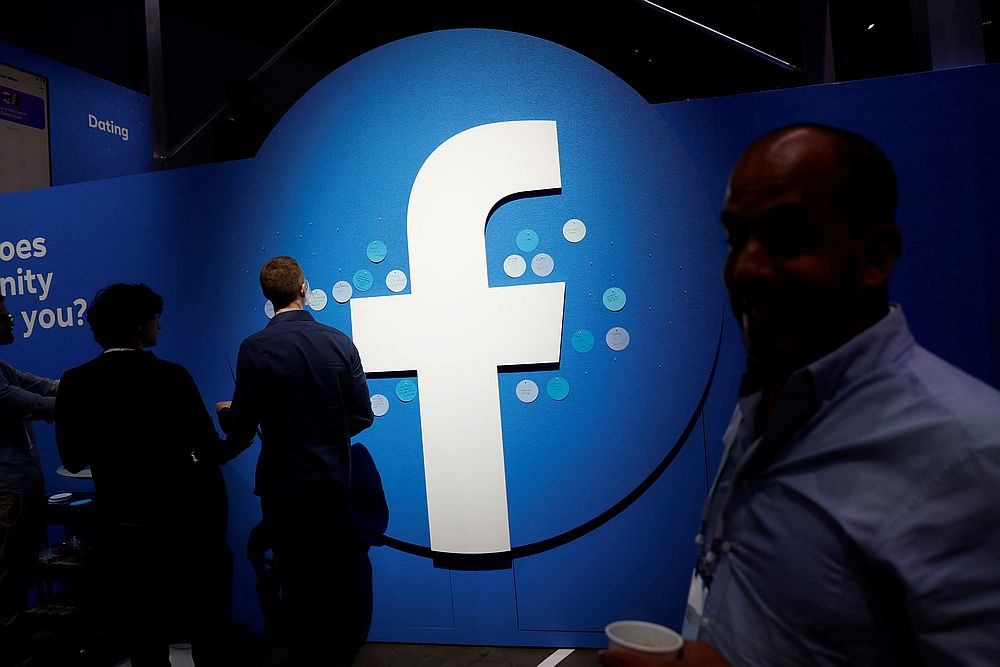 Attendees walk past a Facebook logo during Facebook Inc's F8 developers conference in San Jose, California April 30, 2019. — Reuters pic