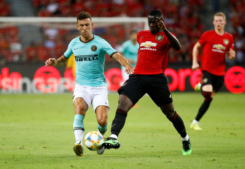 Manchester United's Eric Bailly in action with Inter Milan's Ivan Perisic (left) at the Singapore National Stadium July 20, 2019. — Reuters pic