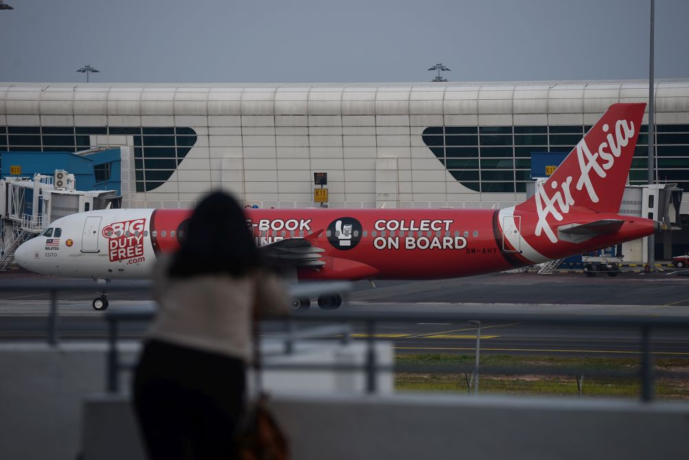 An AirAsia plane is pictured on the tarmac of the Kuala Lumpur International Airport in Sepang August 20, 2019. — Picture by Miera Zulyana