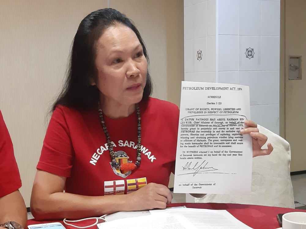 STAR president Lina Soo showing an agreement signed by former Chief Minister the late Tun Abdul Rahman Ya'kub granting in perpetuity the rights, powers, liberties and privileges in respect of petroleum , August 22, 2019. ― Picture by Sulok Tawie