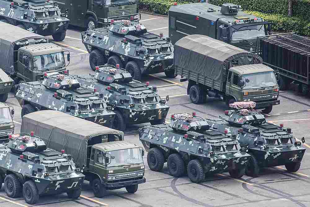 Military vehicles are parked on the grounds of the Shenzhen Bay Sports Centre in Shenzhen, China August 15, 2019. — Reuters pic