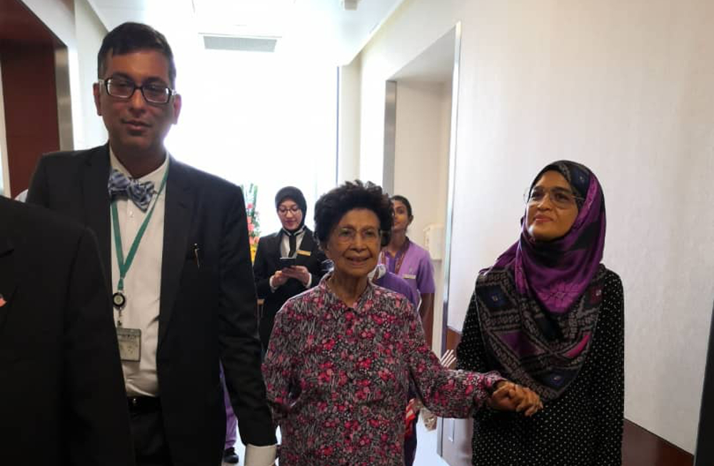 Tun Dr Siti Hasmah Mohamad Ali leaving the Prince Court Medical Centre accompanied by hospital staff today. — Picture courtesy of Prime Minister's Office