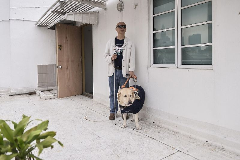 Chan with his loyal guide dog LaShawn. ― Pictures by Miera Zulyana