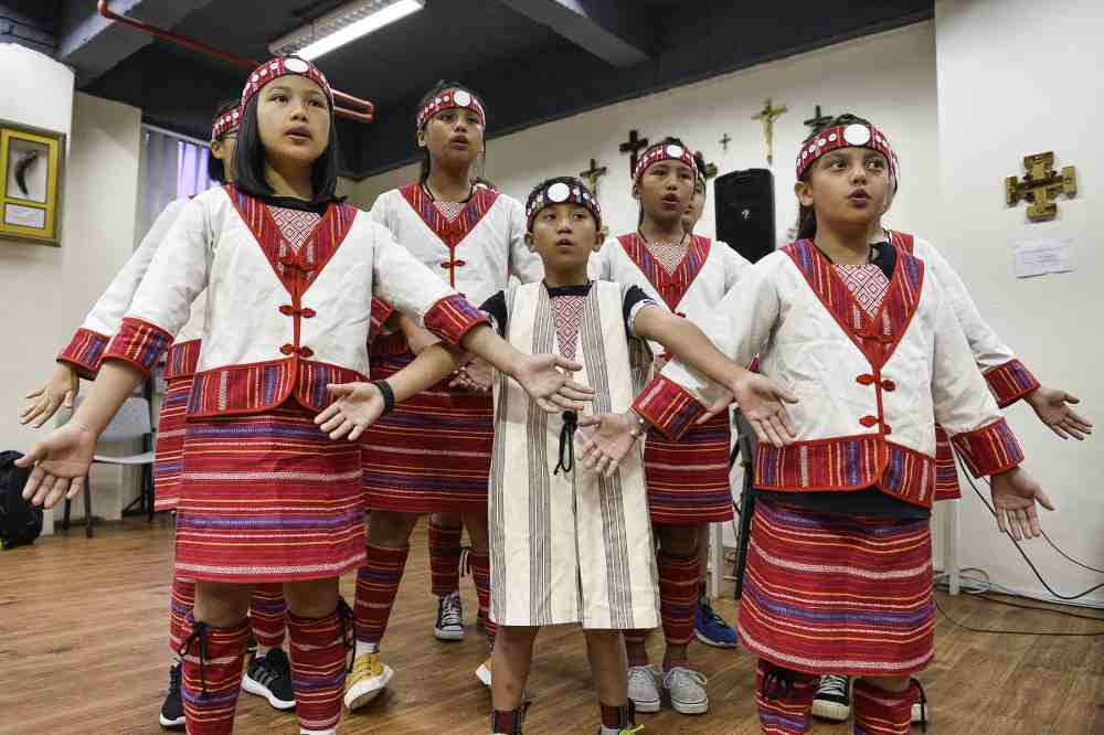 Singing with the choir puts the Atayal children in touch with their roots while showcasing their talents to a global audience. — Pictures by Miera Zulyana
