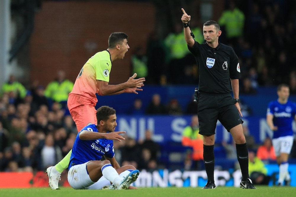 Manchester City's Rodrigo protests before getting a yellow card for his foul on Everton's Dominic Calvert-Lewin during their Premier League match at Goodison Park in Liverpool September 28, 2019. — AFP pic