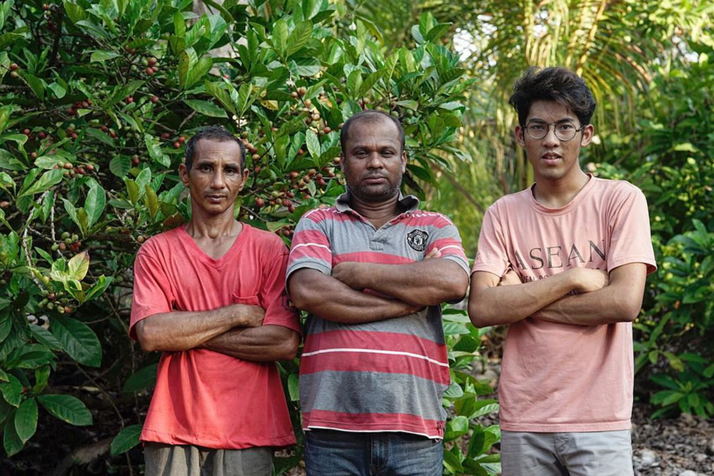 Adam Esham from House of Kendal (right) with two coffee pickers at the 'kebun'. — Picture courtesy of House of Kendal