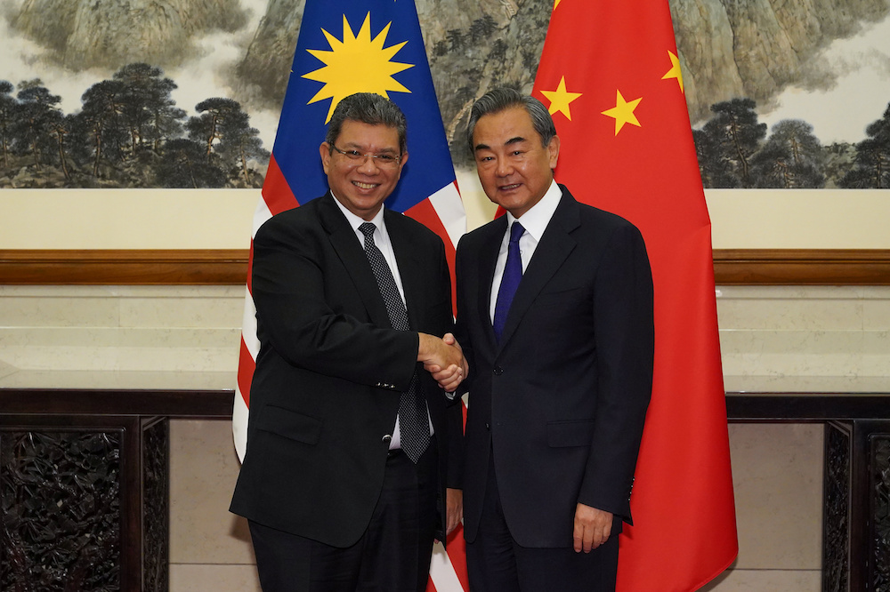 Chinese Foreign Minister Wang Yi shakes hands with Malaysian Foreign Minister Datuk Saifuddin Abdullah during a meeting at the Diaoyutai State Guesthouse, Beijing September 12, 2019. — Reuters pic