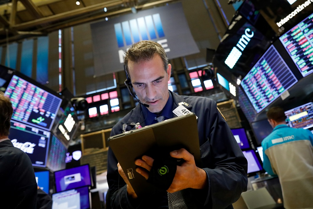 Traders work on the floor at the New York Stock Exchange September 12, 2019. — Reuters pic
