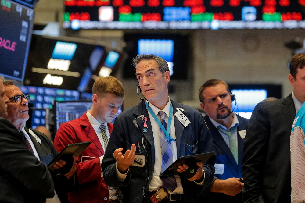 Traders work on the floor at the New York Stock Exchange September 18, 2019. — Reuters pic
