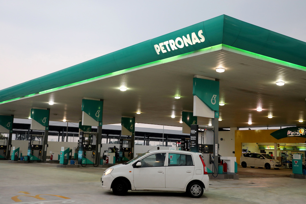 A car passes by a Petronas petrol station in Kuala Lumpur July 31, 2019. — Reuters pic