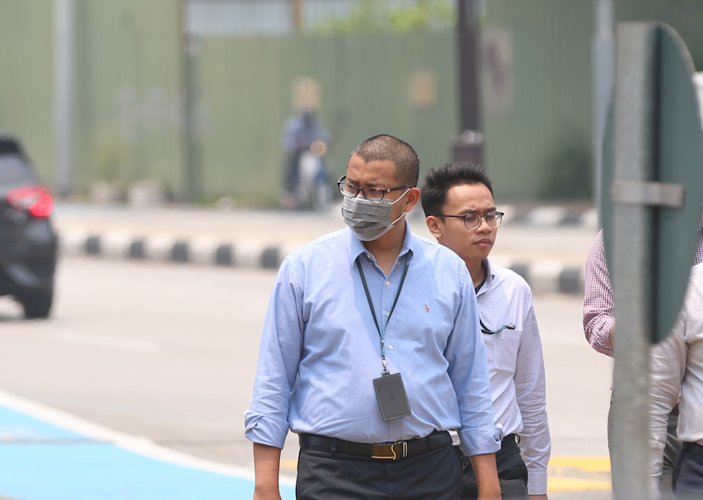 A man wears a mask as haze blankets Kuala Lumpur September 12, 2019. — Picture by Firdaus Latif