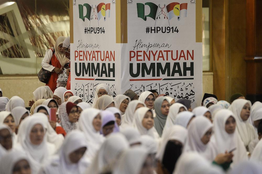 PAS-Umno supporters attend Himpunan Penyatuan Ummah (Muslim Unity Rally) at Putra World Trade Centre in Kuala Lumpur September 13, 2019. — Picture by Miera Zulyana