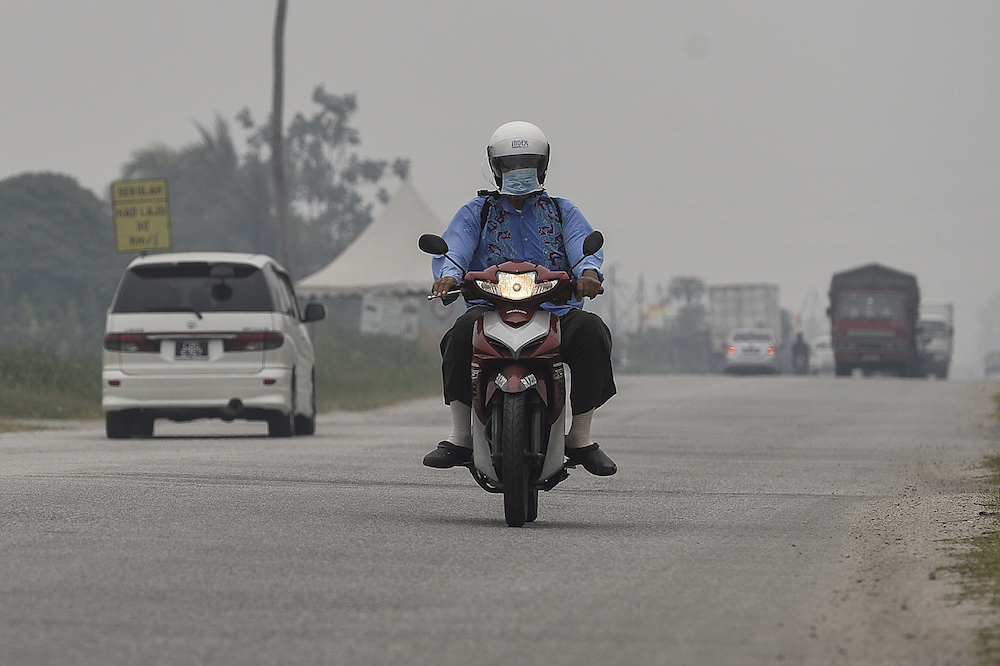 A motorcyclist travels along a road in Kampung Johan Setia in Klang September 18, 2019. — Picture by Miera Zulyana