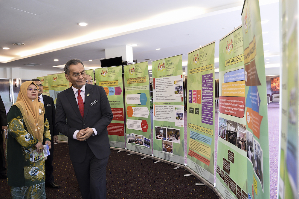 Health Minister Datuk Seri Dzulkefly Ahmad visits a booth during the launch of the National Environmental Health Action Plan 2019 in Putrajaya September 24, 2019. — Picture by Miera Zulyana