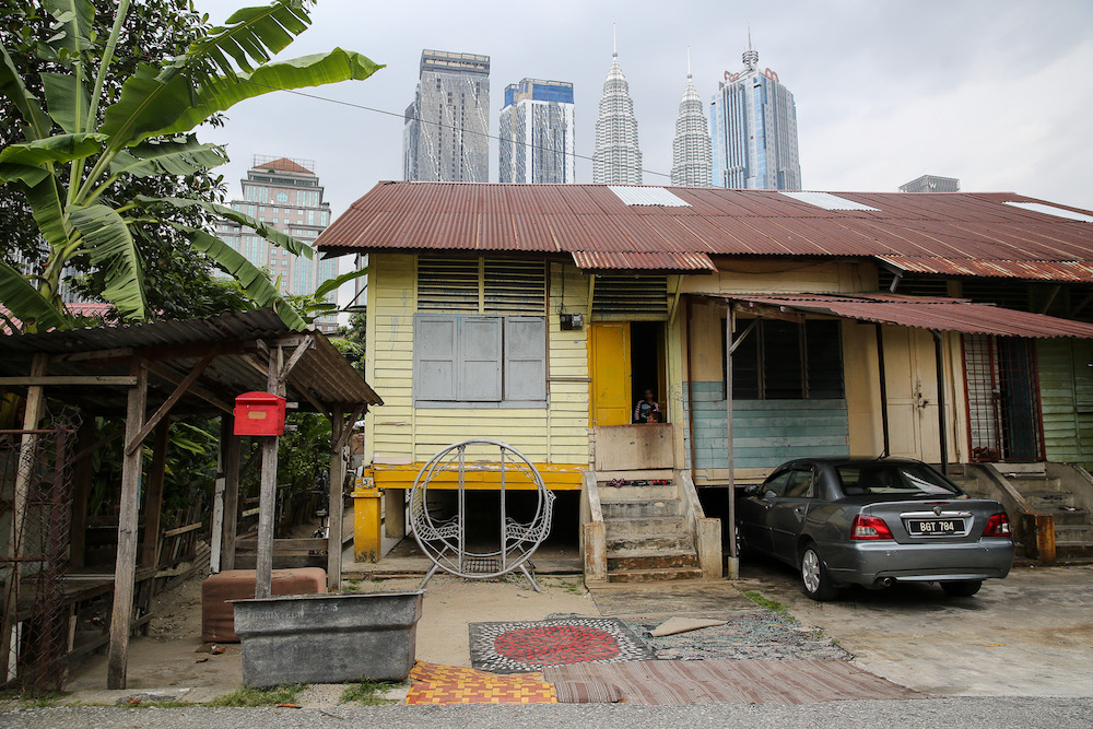 To convince residents to sell their land, public officials often point to the kampung's somewhat shabby image, awkwardly placed amid a bustling and rapidly developing modern city. — Picture by Yusof Mat Isa