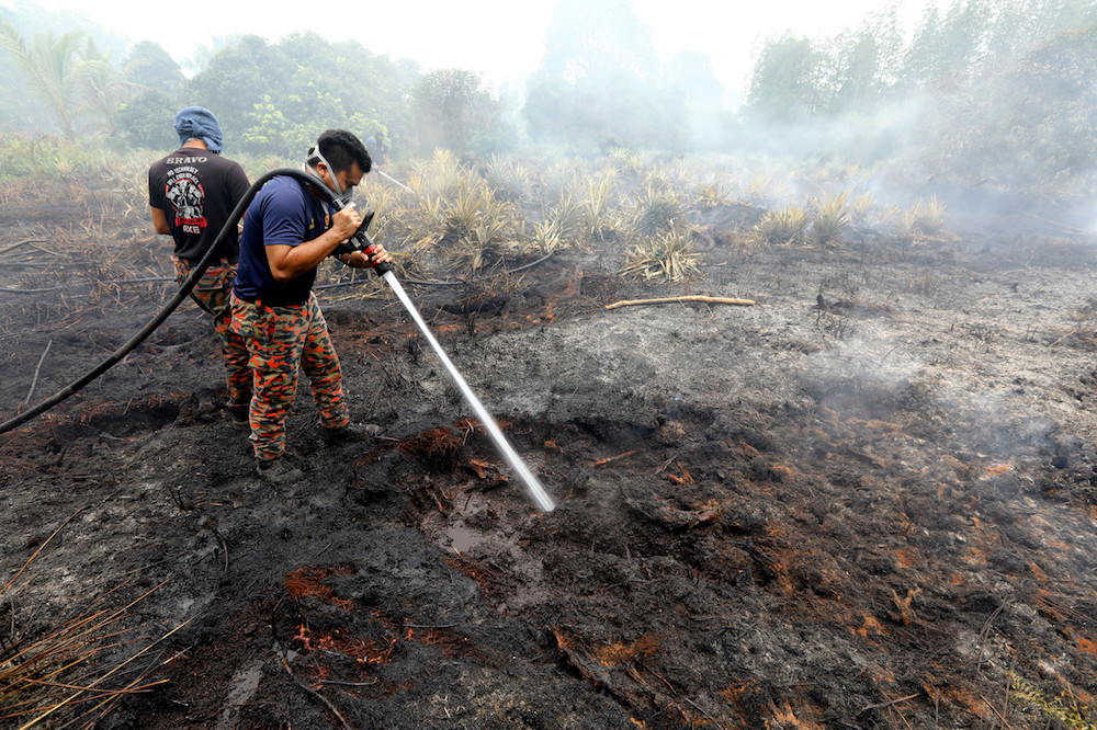 File picture of Sri Aman Fire and Rescue Department personnel working to put out a forest fire in Kampung STC Sri Aman September 19, 2019. — Bernama pic