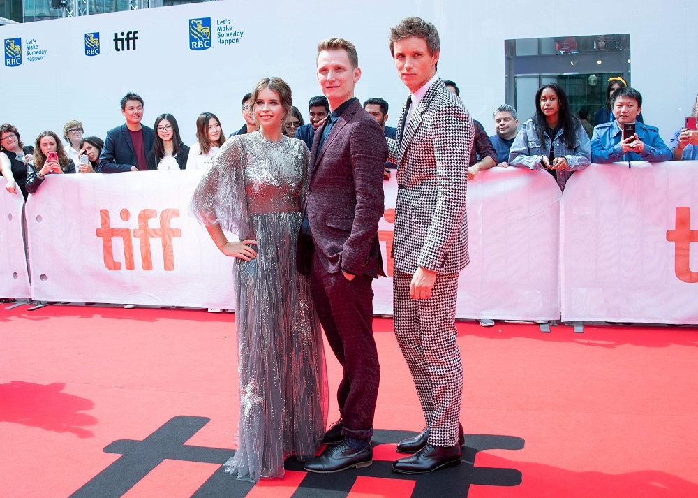 From left: Actress Felicity Jones, director Tom Harper and actor Eddie Redmayne attend 'The Aeronauts' premiere at the Roy Thompson Hall during the 2019 Toronto International Film Festival in Toronto, Ontario September 8, 2019. — AFP pic