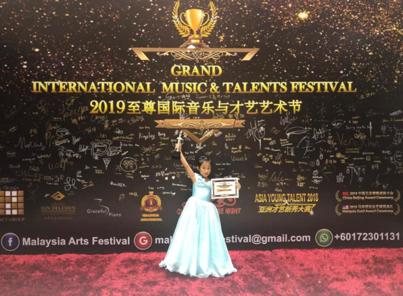 Olivia Lim Ling, 6, celebrating winning the Grand International Music and Talents Festival in Genting Highlands earlier this year. — Picture from Facebook/Ng Kee Ling
