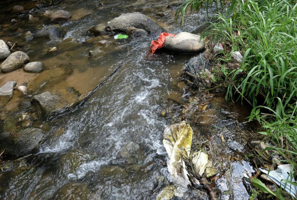 File picture of trash in Sungai Ichat. — Bernama pic
