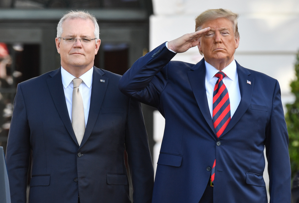 US President Donald Trump stands at attention with Australian Prime Minister Scott Morrison during an Official Visit by the Australian PM at the White House in Washington, DC September 20, 2019. — AFP pic