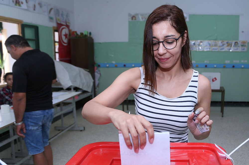 A Tunisian voter casts her ballot for presidential election at a polling station in Sousse, south of the capital Tunis September 15, 2019. — AFP pic