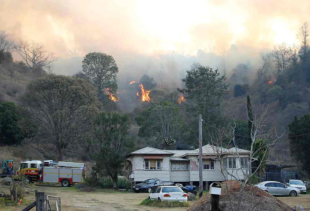 With bushland tinder-box dry, authorities warned locals near existing blazes that fires could spread. — Regi Varghese/AAP pic via Reuters