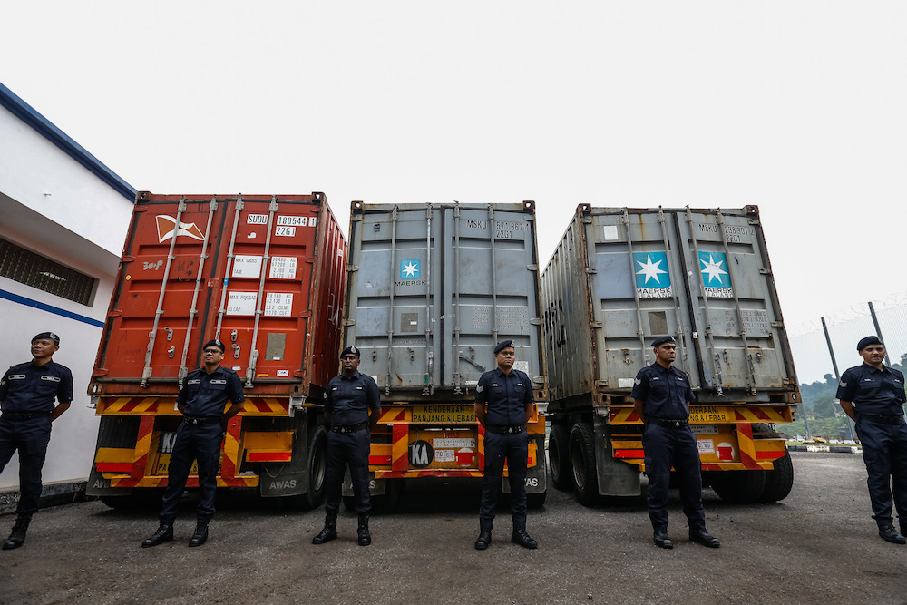 Police guard the 12 tonnes of cocaine seized from three containers at Bayan Baru Police Station September 20, 2019. — Picture by Sayuti Zainudin