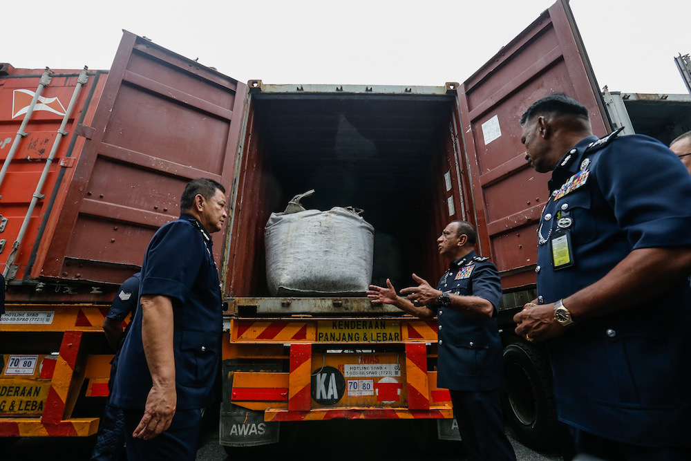 Inspector General of Police Tan Sri Abdul Hamid Bador and other officers examine the 12-tonnes of cocaine seized from three containers at Bayan Baru Police Station September 20, 2019. — Picture by Sayuti Zainudin