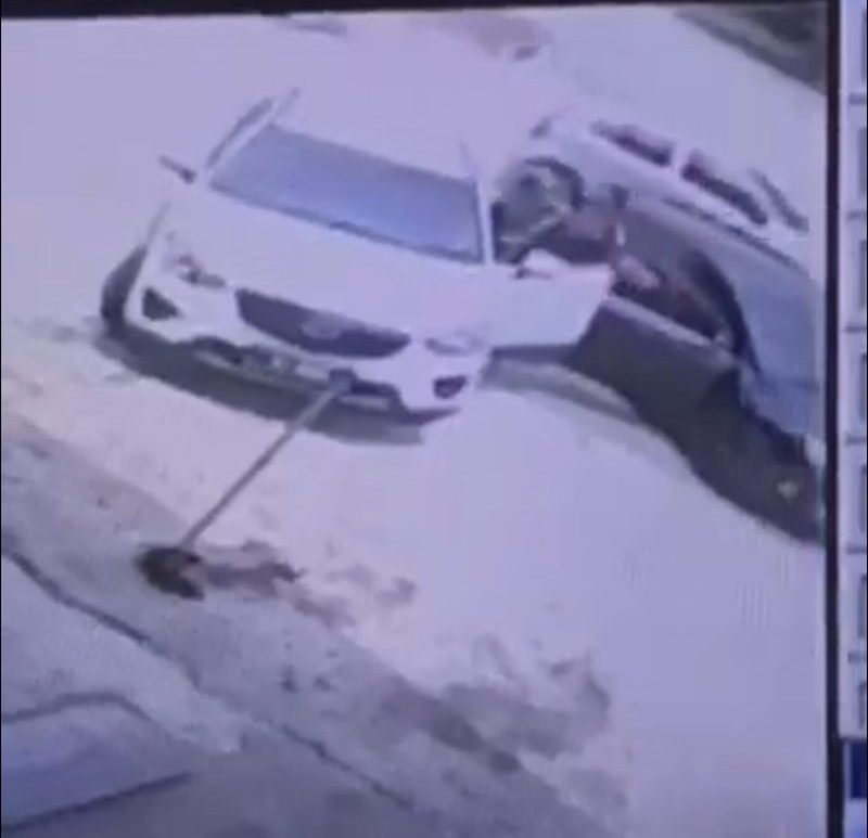 A man who is allegedly a doctor was filmed beating up a woman and an older man after blocking their car. ― Screenshot via social media