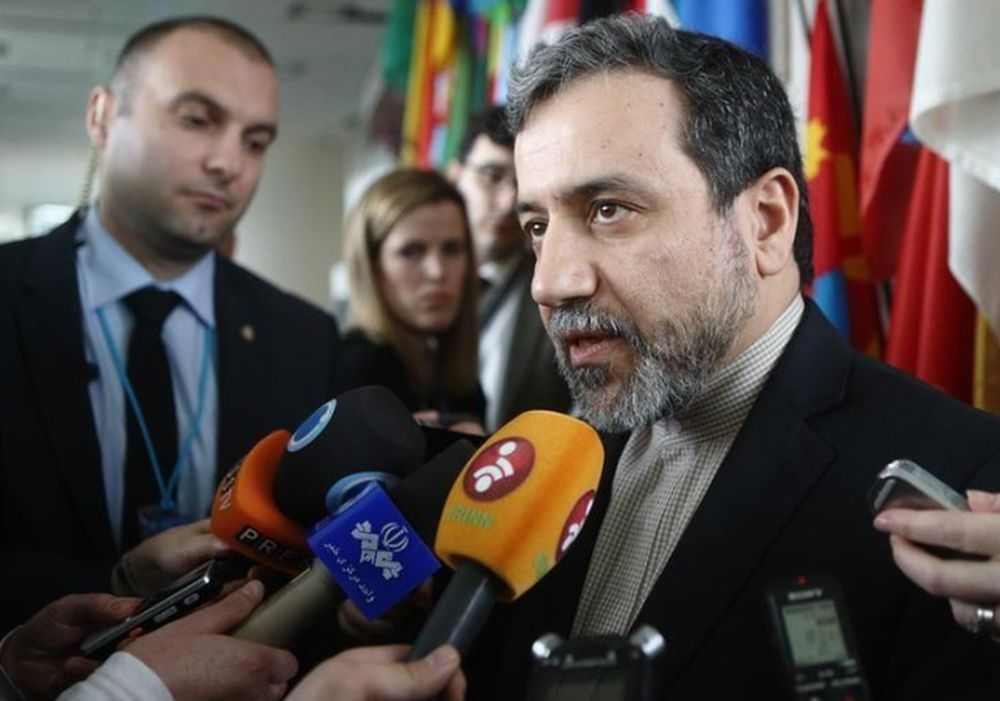 File picture shows Iran's chief nuclear negotiator Abbas Araghchi talking to the media at the IAEA headquarters in Vienna February 24, 2015. — Reuters pic