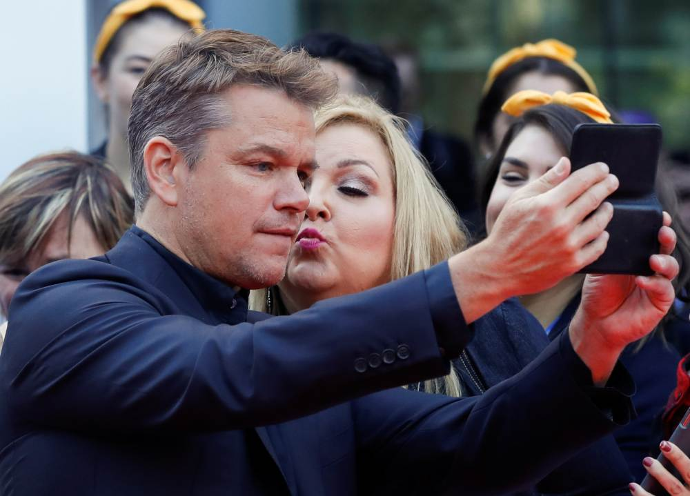 Actor Matt Damon poses with a fan as he arrives at the international premiere of 'Ford V Ferrari' at the Toronto International Film Festival (TIFF) in Toronto September 9, 2019. ― Reuters pic