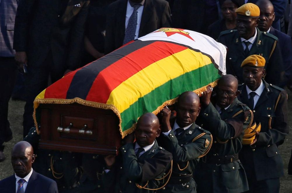 File picture shows the casket carrying the remains of former Zimbabwean president Robert Mugabe being carried to the military chopper after his body lied in state at the Rufaro stadium, in Mbare, Harare, Zimbabwe, September 13, 2019. — Reuters pic