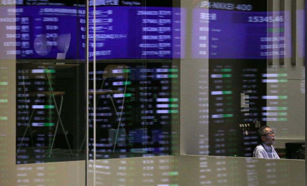 Market prices are reflected in a glass window at the Tokyo Stock Exchange (TSE) in Tokyo, Japan, February 6, 2018. — Reuters pic