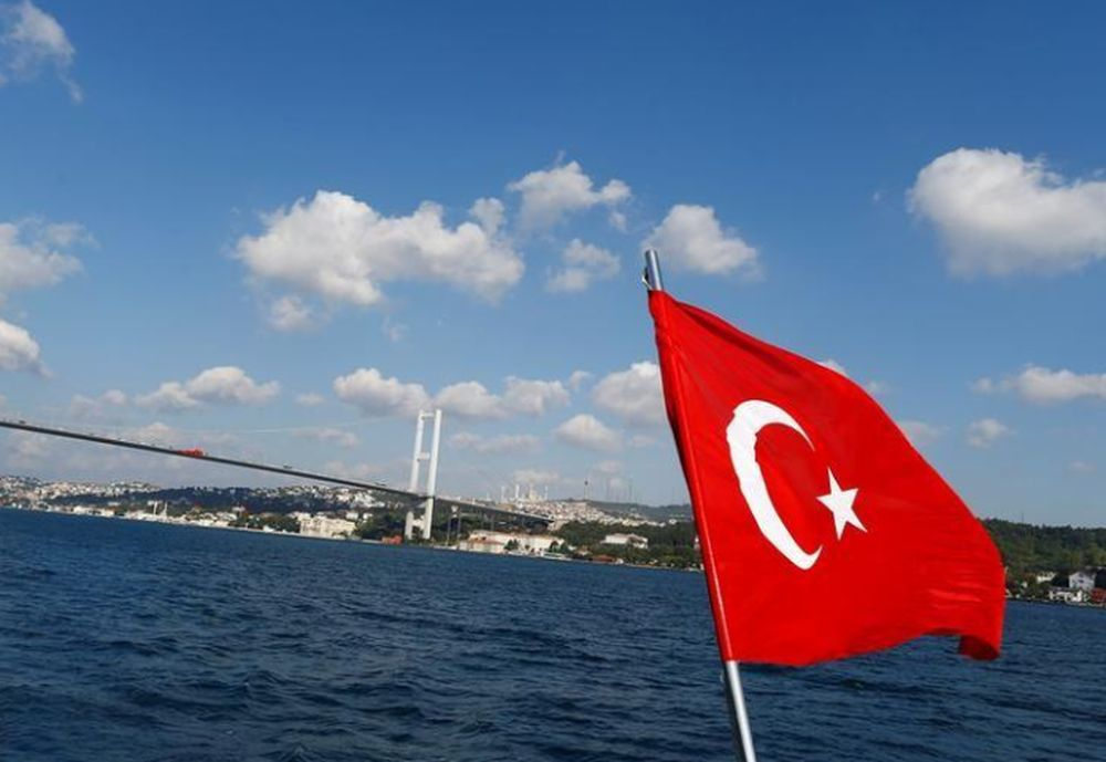 A Turkish flag is pictured on a boat with the Bosphorus bridge in the background in Istanbul, Turkey, August 6, 2016. — Reuters pic