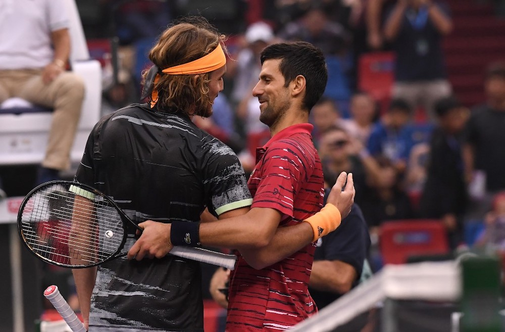 Stefanos Tsitsipas of Greece speaks with Novak Djokovic of Serbia after winning their men's singles quarter-final match at the Shanghai Masters October 11, 2019. — AFP pic