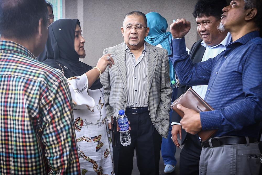 Former Felda chairman Tan Sri Mohd Isa Abdul Samad is seen at the Kuala Lumpur Court Complex, October 8, 2019. — Picture by Hari Anggara