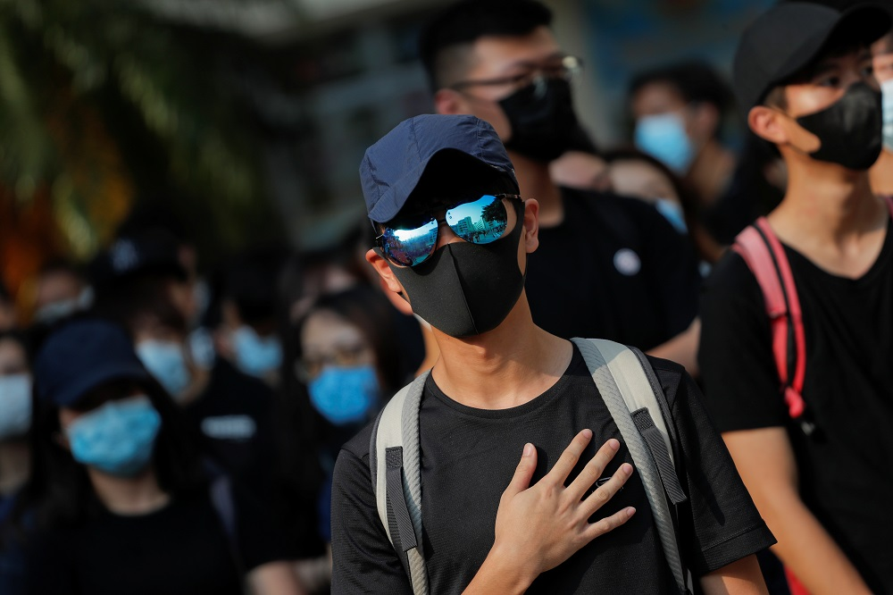 An alumnus of Tsuen Wan Public Ho Chuen Yiu Memorial College reacts during a student gathering at the school in solidarity with the student protester who was shot by a policeman in Hong Kong October 2, 2019. — Reuters pic