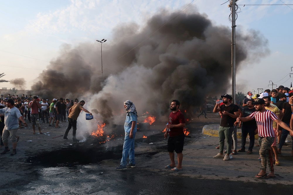 Demonstrators gather as they block the road with burning tires during a protest over unemployment, corruption and poor public services, in Baghdad, Iraq October 2, 2019. — Reuters pic