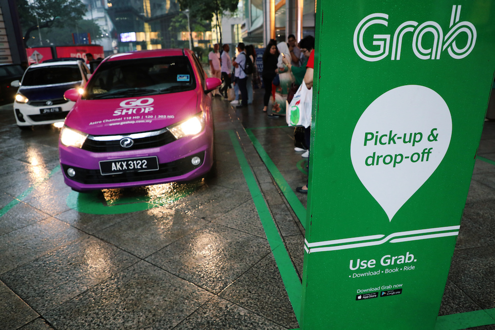 A Grab pick-up and drop-off station is seen at the entrance of Kuala Lumpur City Centre in Kuala Lumpur October 3, 2019. — Reuters pic