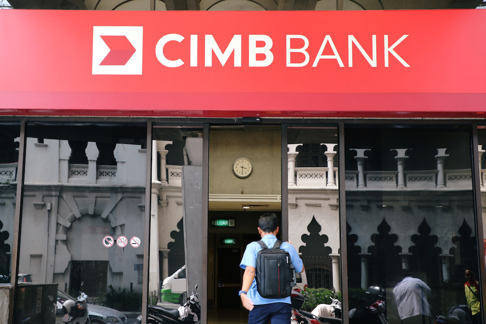 A man walks into a branch of CIMB bank in Kuala Lumpur August 6, 2019. — Reuters pic