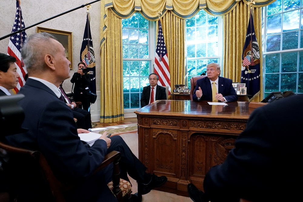 US President Donald Trump speaks during a meeting with China's Vice Premier Liu He in the Oval Office at the White House after two days of trade negotiations in Washington October 11, 2019. — Reuters pic