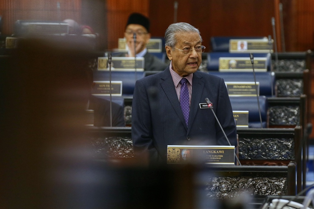 Prime Minister Tun Dr Mahathir Mohamad answers questions in Parliament October 8, 2019. — Picture by Ahmad Zamzahuri