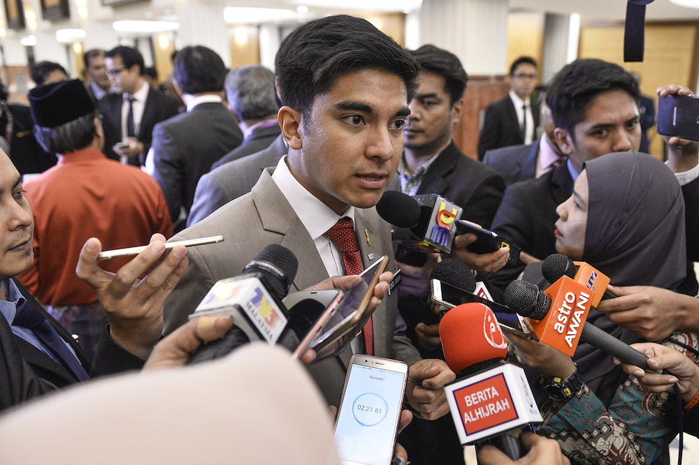 Syed Saddiq Abdul Rahman speaks to reporters in Parliament after the tabling of Budget 2020 on October 11, 2019. — Picture by Miera Zulyana
