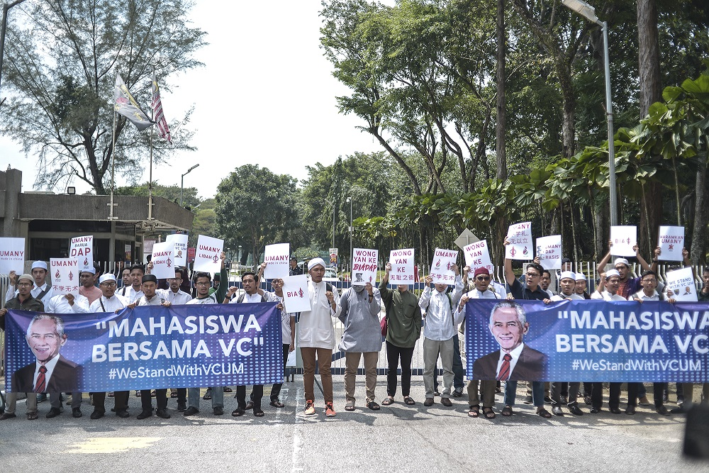 Universiti Malaya students hold placards and large banners in support of vice-chancellor Datuk Abdul Rahim Hashim during a protest at the university in Kuala Lumpur October 25, 2019. — Picture by Shafwan Zaidon