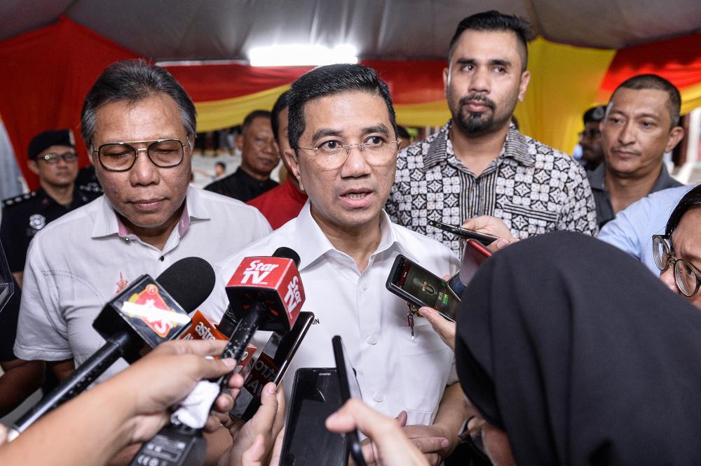 Economic Affairs Minister Datuk Seri Mohamed Azmin Ali speaks to reporters at Sekolah Menengah Telok Gadong, Klang October 12,2019. — Picture by Miera Zulyana